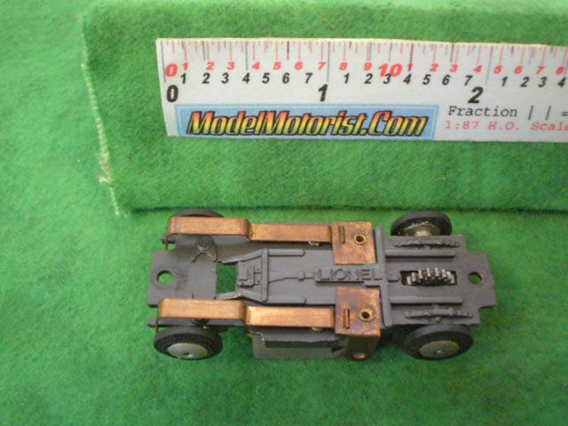 Bottom view of Lionel HO Slot Car Chassis (Gray)