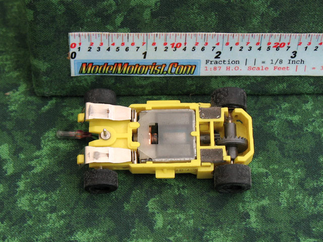 Bottom view of MR1 Lighted Yellow HO Slot Car Chassis