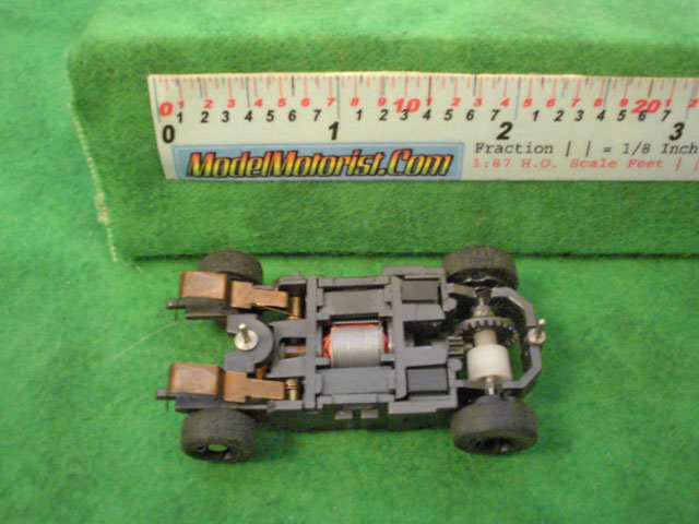 Bottom view of Mattel HPX2 Harry Potter HO Slot Car Chassis