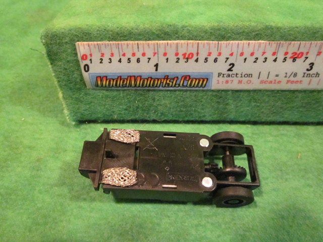 Bottom view of MicroScalextric Bicycle HO Slot Car Chassis