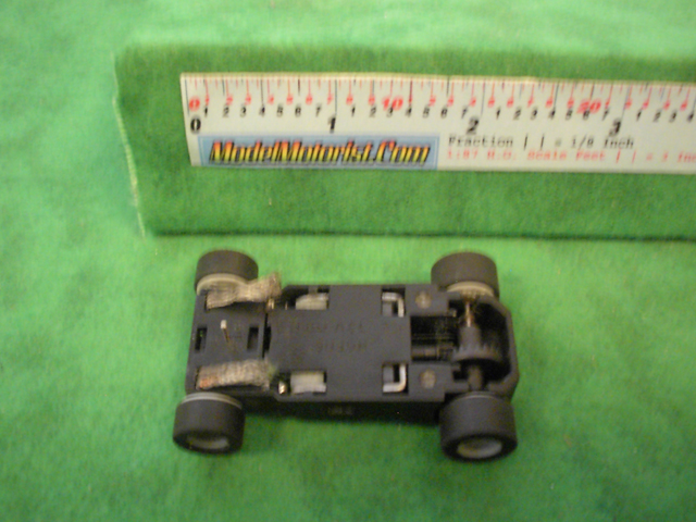 Bottom view of MicroScalextric Narrow Mount HO Slot Car Chassis