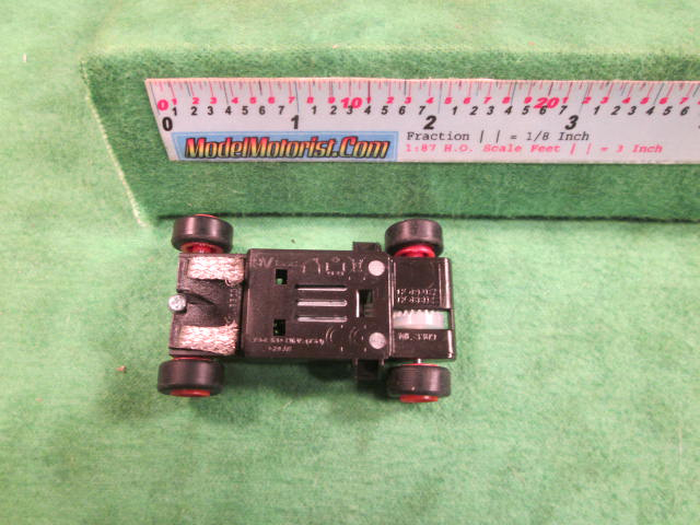 Bottom view of MicroScalextric 9 Volt HO Slot Car Chassis