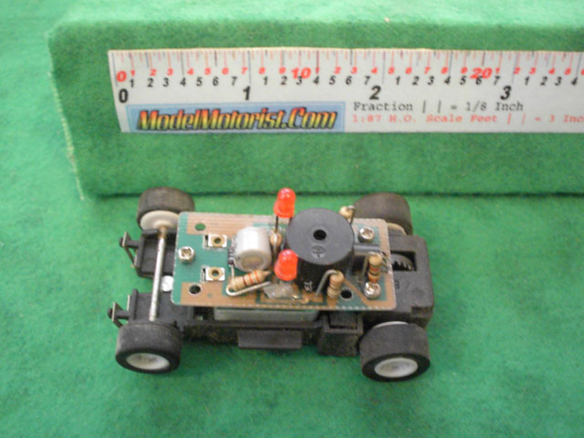 Top view of MR1 Racing Orange 911 HO Slot Car Chassis