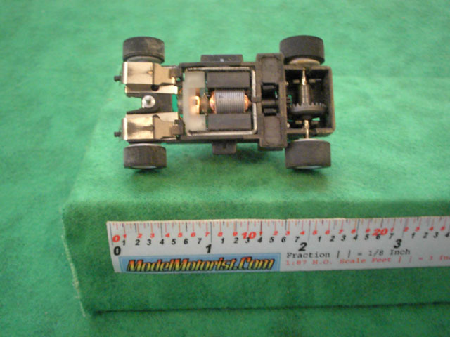 Bottom view of MR1 Racing Orange 911 HO Slot Car Chassis