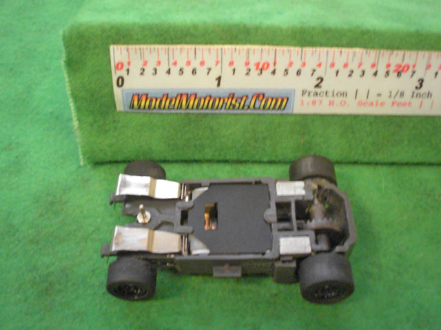 Bottom view of Empire MR1 Racing HO Slot Car Chassis