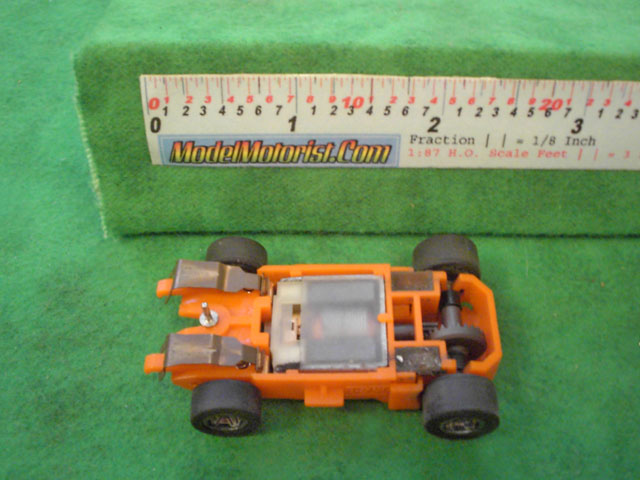 Bottom view of MR1 Racing Orange HO Slot Car Chassis