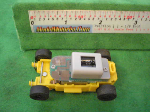 Top view of MR1 Racing Yellow 911 HO Slot Car Chassis