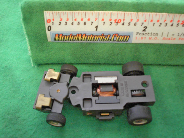 Bottom view of Aurora Magna-Steering Slot Car Chassis