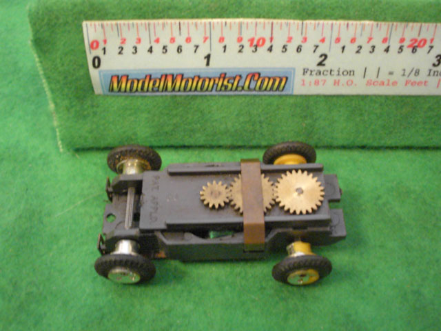 Top view of Aurora Thunderjet Trucks Slot Car Chassis