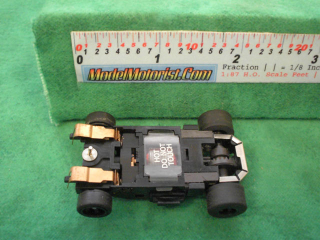 Bottom view of Aurora Tomy Super G+ with Metal Clip Slot Car Chassis