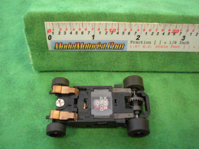 Bottom view of Aurora Tomy Super G+ Slot Car Chassis