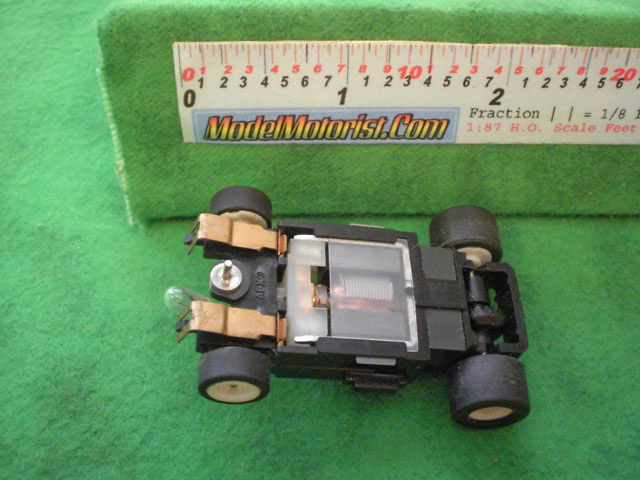 Bottom view of Aurora Tomy Lighted Turbo Slot Car Narrow Chassis