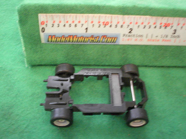 Bottom view of Tyco TR-X Follower HO Slot Car Chassis