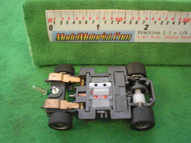 Bottom view of Tyco Lighted Magnum 440 Wide HO Slot Car Chassis