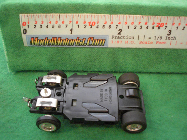 Bottom view of Tyco Lighted Curve Hugger Slot Car Chassis