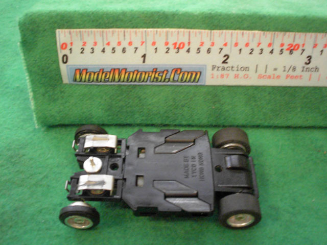 Bottom view of Tyco Curve Hugger Slot Car Chassis