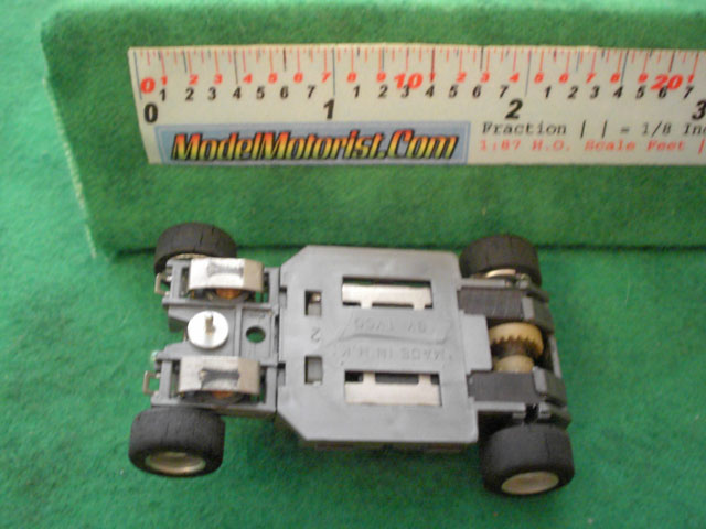 Bottom view of Tyco HP-2 Lighted Curve Hugger HO Slot Car Chassis
