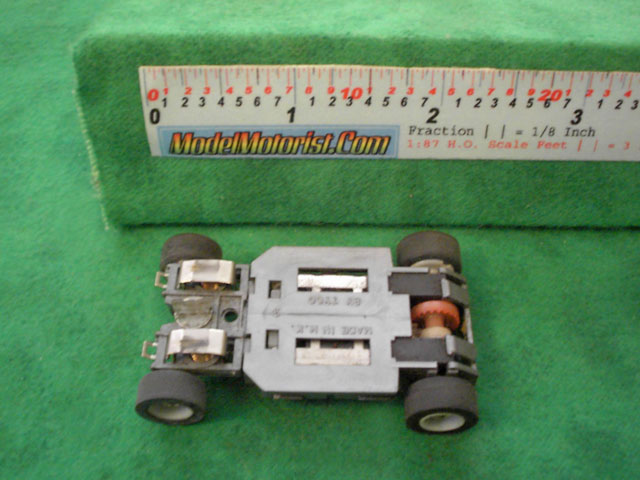 Bottom view of Tyco HP-2 Curve Hugger HO Slot Car Chassis
