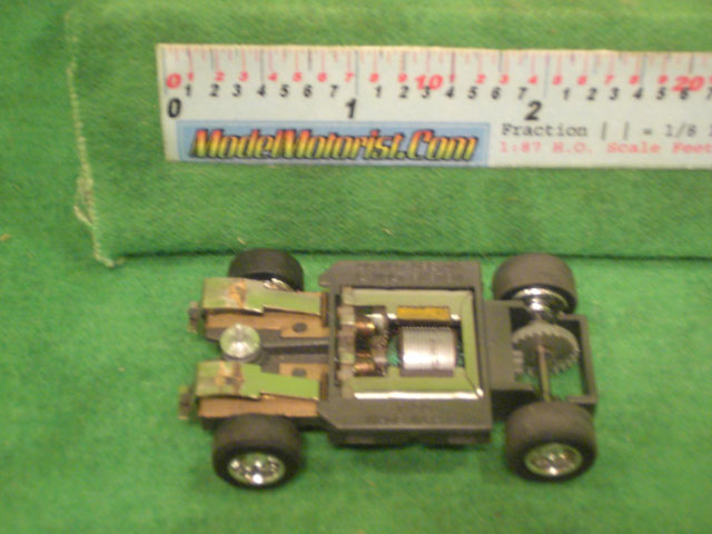 Bottom view of Tyco Hustler HO Slot Car Chassis