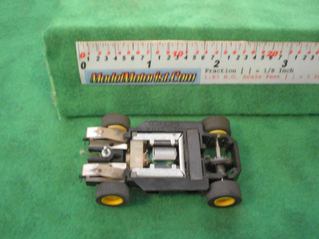 Bottom view of Tyco Lighted HP-7 HO Slot Car Chassis