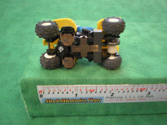Bottom view of Tyco Quad-Hopper Slot Car Chassis