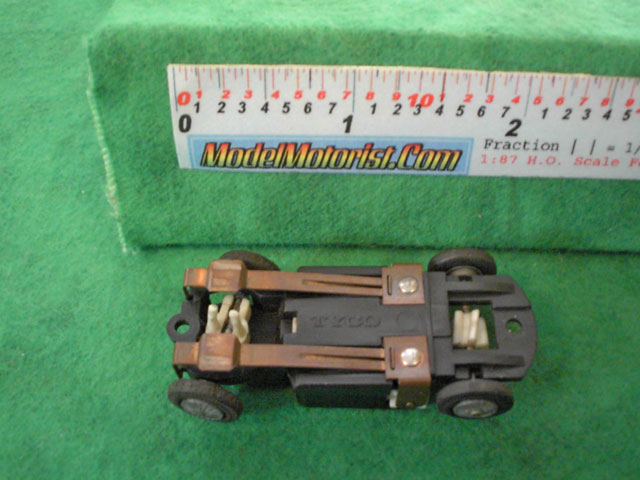 Bottom view of Tyco S Steering HO Slot Car Chassis