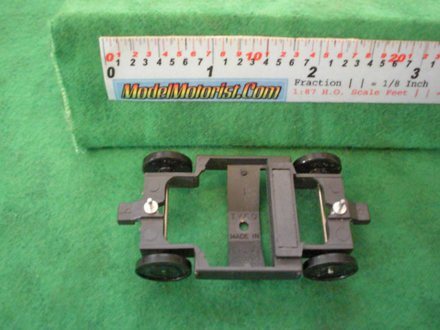 Bottom view of Tyco Turbo Train HO Dummy Car Chassis
