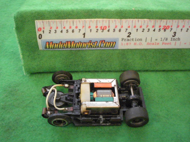 Top view of Tyco TycoPro Lighted with Dropdown Arm HO Slot Car Chassis