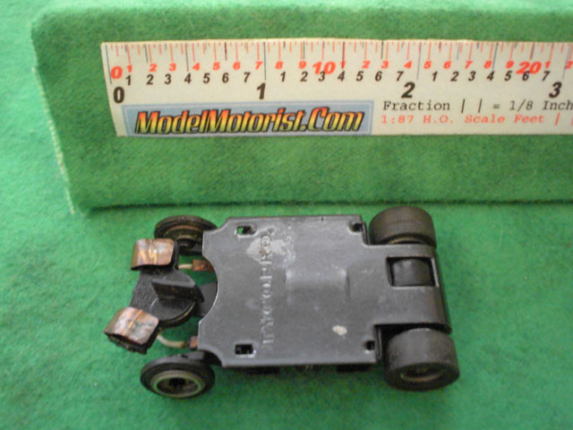 Bottom view of Tyco TycoPro Lighted with Dropdown Arm HO Slot Car Chassis