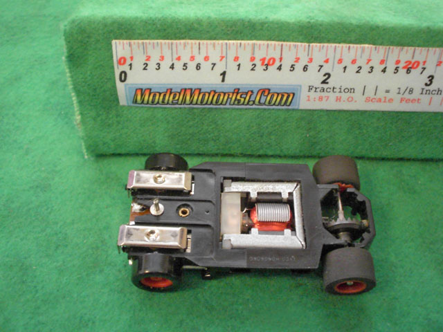 Bottom view of Tyco U-Turn HO Slot Car Chassis